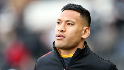 Israel Folau berated for not kneeling at game