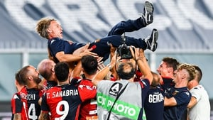 Davide Nicola, coach of Genoa, is lifted up by his players in celebration after safety was confirmed