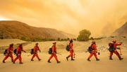 Firefighters arrive at the scene of the Water fire, a new start about 20 miles from the Apple fire in Whitewater, California