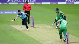 Reece Topley fields off his own bowling during the second ODI with Ireland