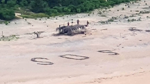 """Australian and US warplanes spotted a giant """"SOS"""" the men had scrawled on the beach (Photo courtesy of Australian Defence Force)"""