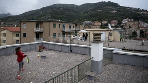 Carola Pessina (foreground) plays with Vittoria Oliveri on the rooftops of their homes during Italy's lockdown in April