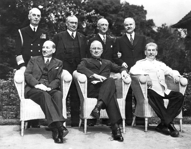The scene in the palace garden at Potsdam as the Big Three posed for photographers just before the final peace conference meeting, Potsdam, Germany, August 10, 1945. Seated left to right: Great Britain Prime Minister Clement Attlee, US President Harry S Truman, and Russian Marshal Josef Stalin; standing left to right are: Admiral William Leahy, Chief of Staff to President Truman, Honorable Ernest Bevin, Britain's Foreign Minister, US Secretary of State James Byrnes, and Russia's Foreign Minister Vyacheslav Molotov. (Photo by Underwood Archives/Getty Images)