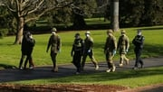 Police and army patrols are seen in the Fitzroy Gardens in Melbourne today