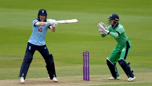 Eoin Morgan chips a shot over Ireland's Lorcan Tucker to reach his half century