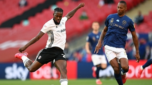Ethan Pinnock of Brentford looks to block the early shot from Josh Onomah