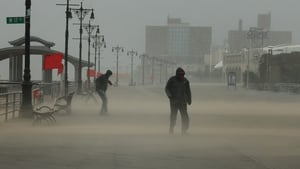The Coney Island boardwalk stands mostly empty as Tropical Storm Isaias churns its way up the East Coast