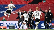 Joe Bryan celebrates with his Fulham team-mates and coaching staff after his Wembley goal