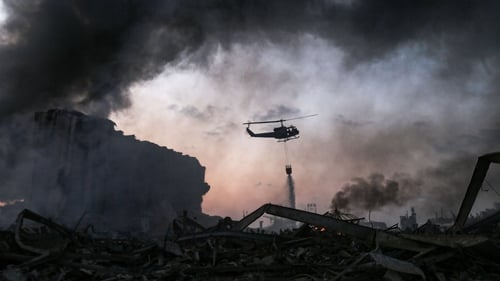 Helicopters are used to help douse the flames