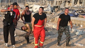 Lebanese rescue workers dig through rubble looking for survivors of the powerful blast that shook the capital Beirut