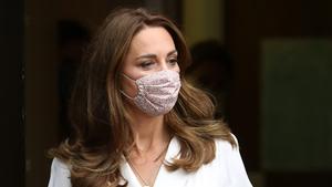 Kate chose a reusable floral face mask. Photo: Getty