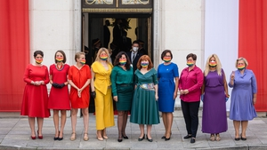 The lawmakers made a statement in brightly coloured clothes and rainbow masks, in a protest against Duda