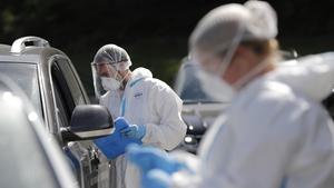 Health workers perform swab tests at a drive-thru Covid-19 testing lab in Namur, Belgium