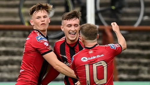 Danny Grant celebrates scoring with Bohemians team-mates Andy Lyons (L) and Keith Ward (R)
