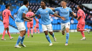 Raheem Sterling celebrates City's early goal