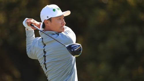 Li Haotong plays his shot from the 12th tee during the second round of the US PGA Championship