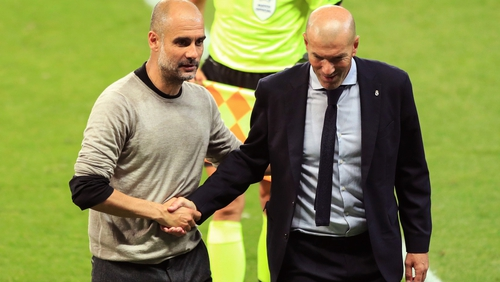 Pep Guardiola consoles opposite number Zinedine Zidane after Manchester City's win at the  Etihad