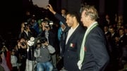 Paul McGrath and Jack Charlton salute the crowd at the homecoming in 1990