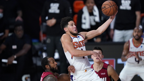 Devin Booker of the Phoenix Suns drives to the basket at Visa Athletic Center