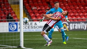 Derry City defender Colm Horgan deflects the ball into his own net for Shamrock Rovers' opening goal