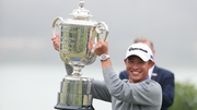 Collin Morikawa celebrates with the Wanamaker Trophy
