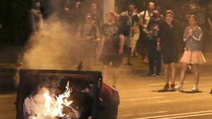 A rubbish bin was set on fire during the protests