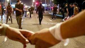 People hold hands during the protest against the election results