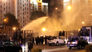 Police use a water cannon against protesters in Minsk
