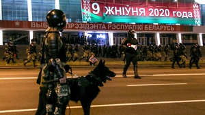 Riot police guard a street during the protest in Minsk