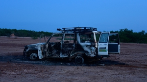 Wreckage of the car found after  eight people were killed by unidentified gunmen in Niger