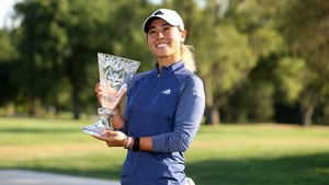 Danielle Kang celebrates with the trophy