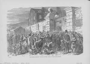 People begging to be allowed enter a workhouse in Ireland, circa 1846