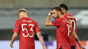 Bruno Fernandes (R) reacts after netting the winning penalty