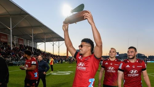 Leicester Faingaanuku of the Crusaders lifts the Super Rugby Aotearoa Trophy