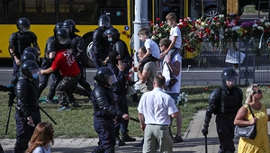 Riot police detain a man participating in a memorial event for the person killed during a protest in Belarus