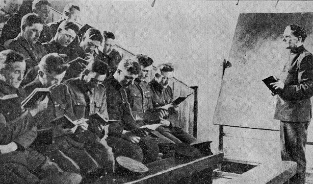 Irish policemen at school - Ex-soldier recruits to the RIC, most of them still wearing their army uniform, in the law school at the depot of the force. They are given six months tuition under a specially qualified tutor. Photo: Daily Mail, 1 April 1920 via Bureau of Military History