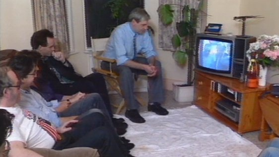 Friends of Brian Keenan watch televised press conference following his return to Ireland (1990)