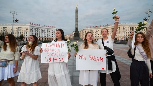 Women dressed in white as they formed a human chain today during protests in Minsk, Belarus