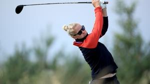 Nicole Larsen plays her tee shot on the 10th hole