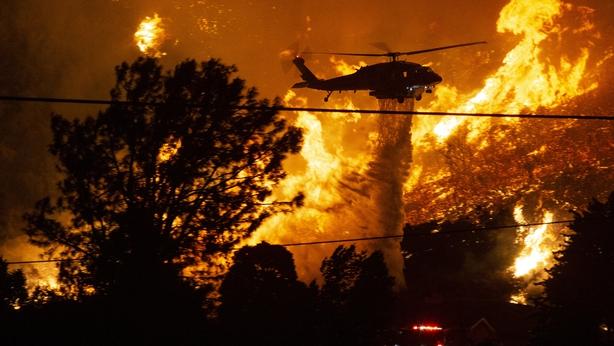 Crews battle wildfires amid brutal heat wave in California