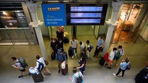 Travellers arrive at St Pancras train station in London