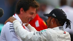 Hamilton has suggested that decisions on his own future could be tied to Wolff's (l) own plans