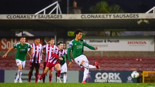 Kit Elliot of Cork City slots home his side's second goal from the penalty spot