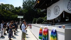 People pray at the Yasukuni shrine in Tokyo