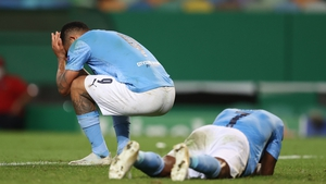 Raheem Sterling of Manchester City and Gabriel Jesus react at the final whistle