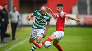 Joey O'Brien of Shamrock Rovers is tackled by Shane Griffin of St Patrick's Athletic
