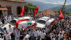 Funerals are held for the victims of the Beirut blast as Covid cases spike