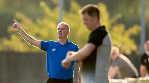 Waterford manager John Sheridan gives orders to his charges, with Vinny Perth in the foreground