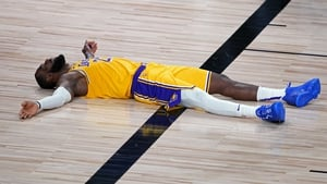 LeBron James Lakers lies on the court floor after committing a foul against the Portland Trail Blazers