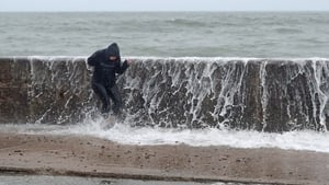 A person is hit by a wave crashing on the Front Strand today in Youghal, Co Cork